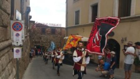Contrade marching through the streets of Montepulciano