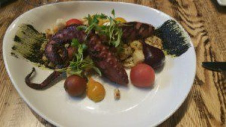 Grilled Octopus, charred cauliflower, sourdough croutons, heirloom tomatoes, red beets, squid ink pesto
