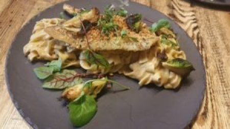 Petrale Sole, hazelnut herb crust, hand-cut pasta, Brussels sprouts, micro cilantro, hazelnut sauce