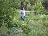 Maria in Christine's food forest