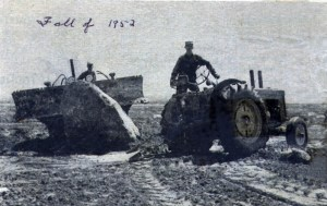 A 1952 image from a newspaper story about the Fast Brothers of Giroux removing stones from a field near Friedensfeld, southeast of Steinbach. Image Credit: Orlando Hiebert.