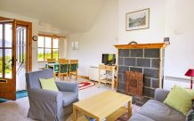 Reraig cottage living area & fireplace