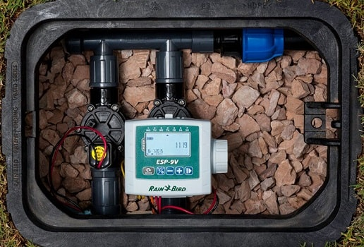 view of the rain bird esp 9v timer within a sprinkler valve box