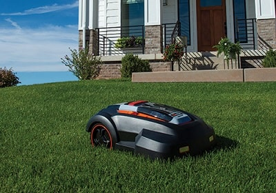 redback robot lawn mower rm24a in yard