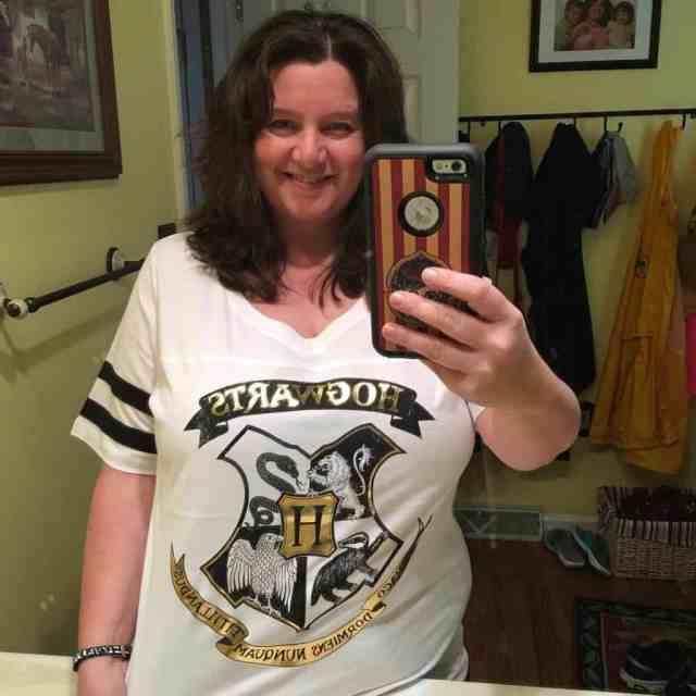 Nancy Basile in Torrid Hogwarts Shield Football Tee
