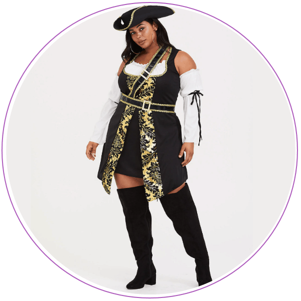 Woman wearing hat and dress and boots for pirate costume