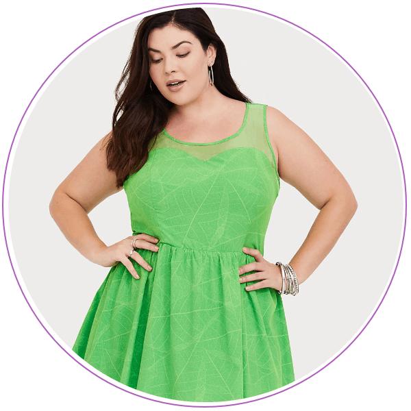 Woman wearing green Tinkerbell dress