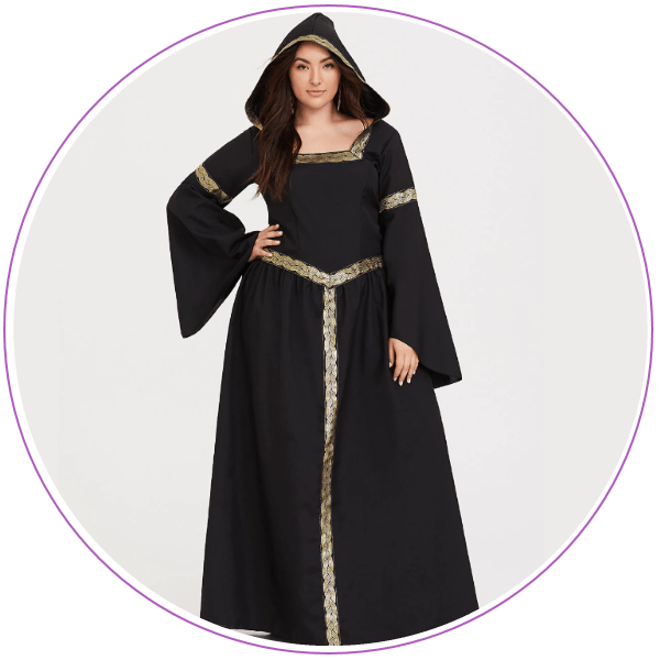 Woman wearing a floor-length witch costume