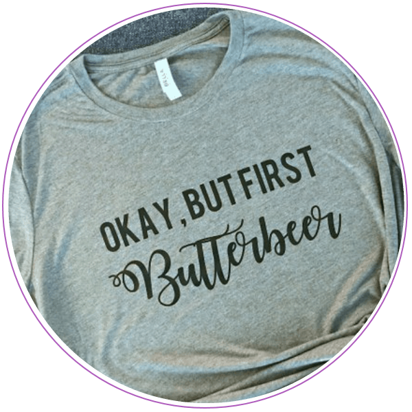 T-shirt that says Okay, but first, butterbeer
