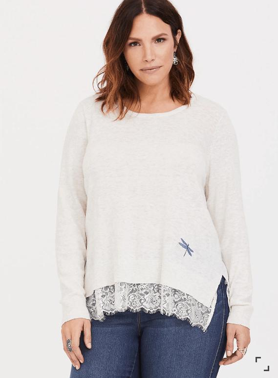 Woman wearing loose-fitting white sweater