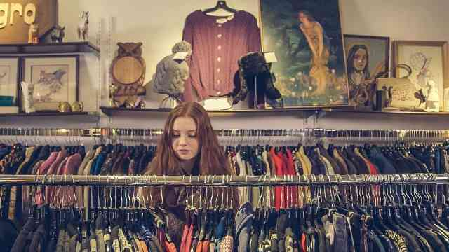 Woman shopping at thrift store