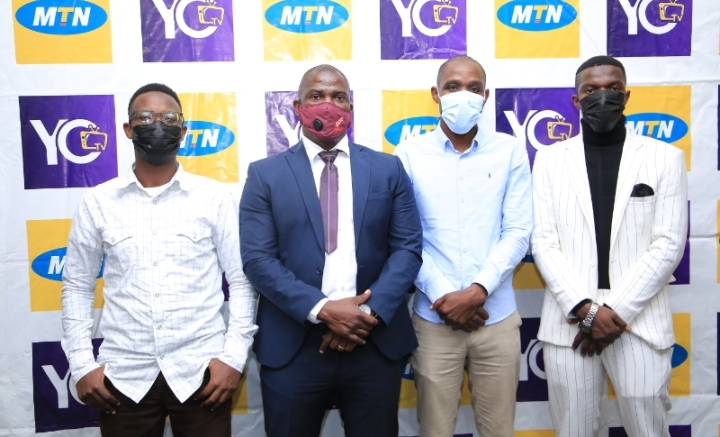 Patrick Sekijjema, CEO Sekispice (U) Ltd (l),MTN Uganda's Manager Digital Services, Onyait Odeke (c) surrounded by the actors of Anandi and Girls' Empire movies premiered on Kibanda Xpress over the weekend