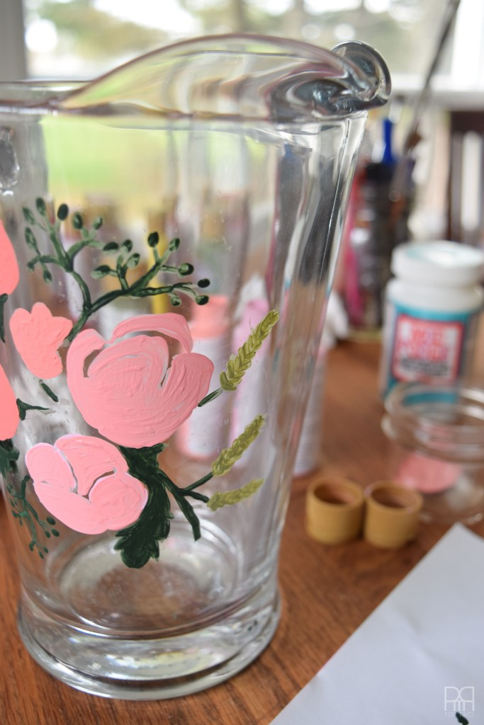 flowers painted on pitcher