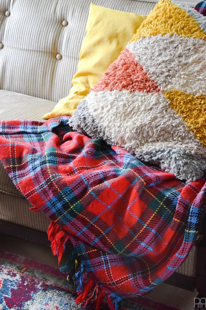 plaid blanket on couch