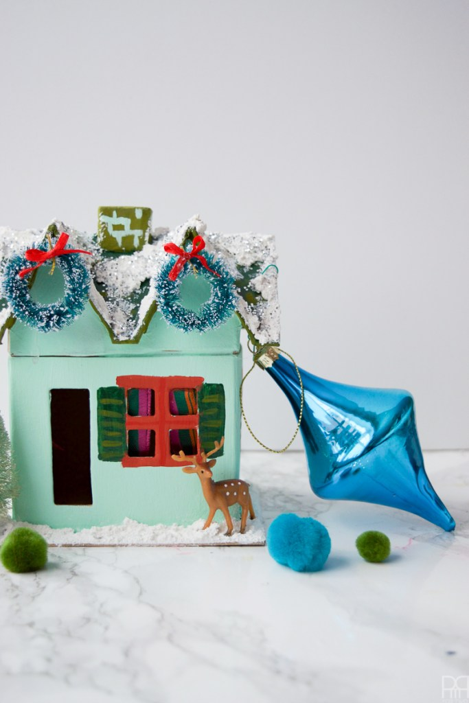Colourful Christmas Putz Houses with blue ornament