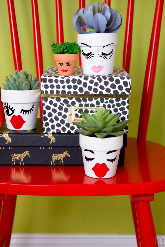 What do you do with all those vinyl scraps?! You make Vinyl Face Succulent Planters of course!