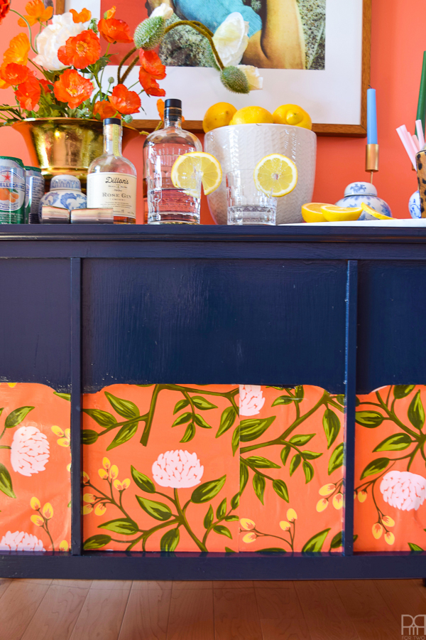 Inspired by Miles Redd's iconic style, I've made-over my MCM laminate buffet using FAT paint and some poly with wallpaper samples. What do you think?