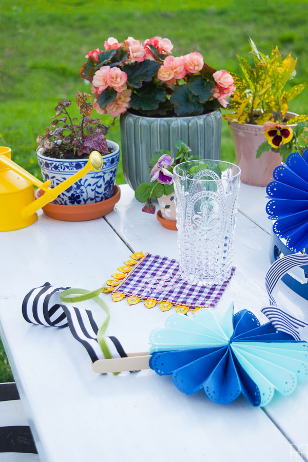 Using my Cricut Explore Air 2 and some colourful card stock and ribbons, I made beautifully paper fans for summer entertaining and outdoor living. Come see how you can make a set for yourself!