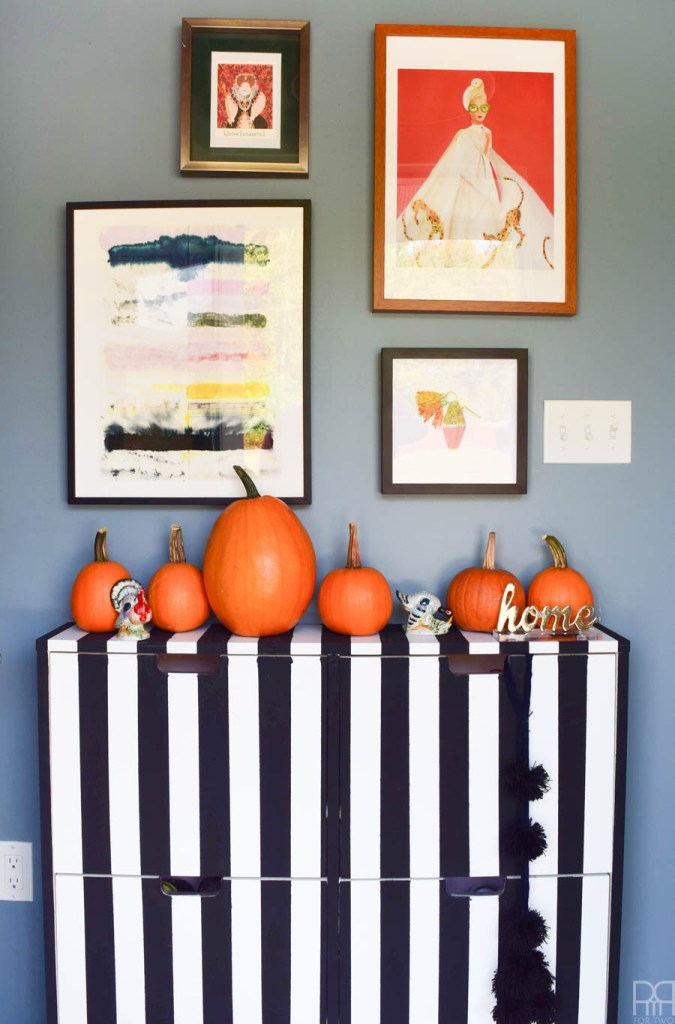 fall entryway with black and white stripped dresser