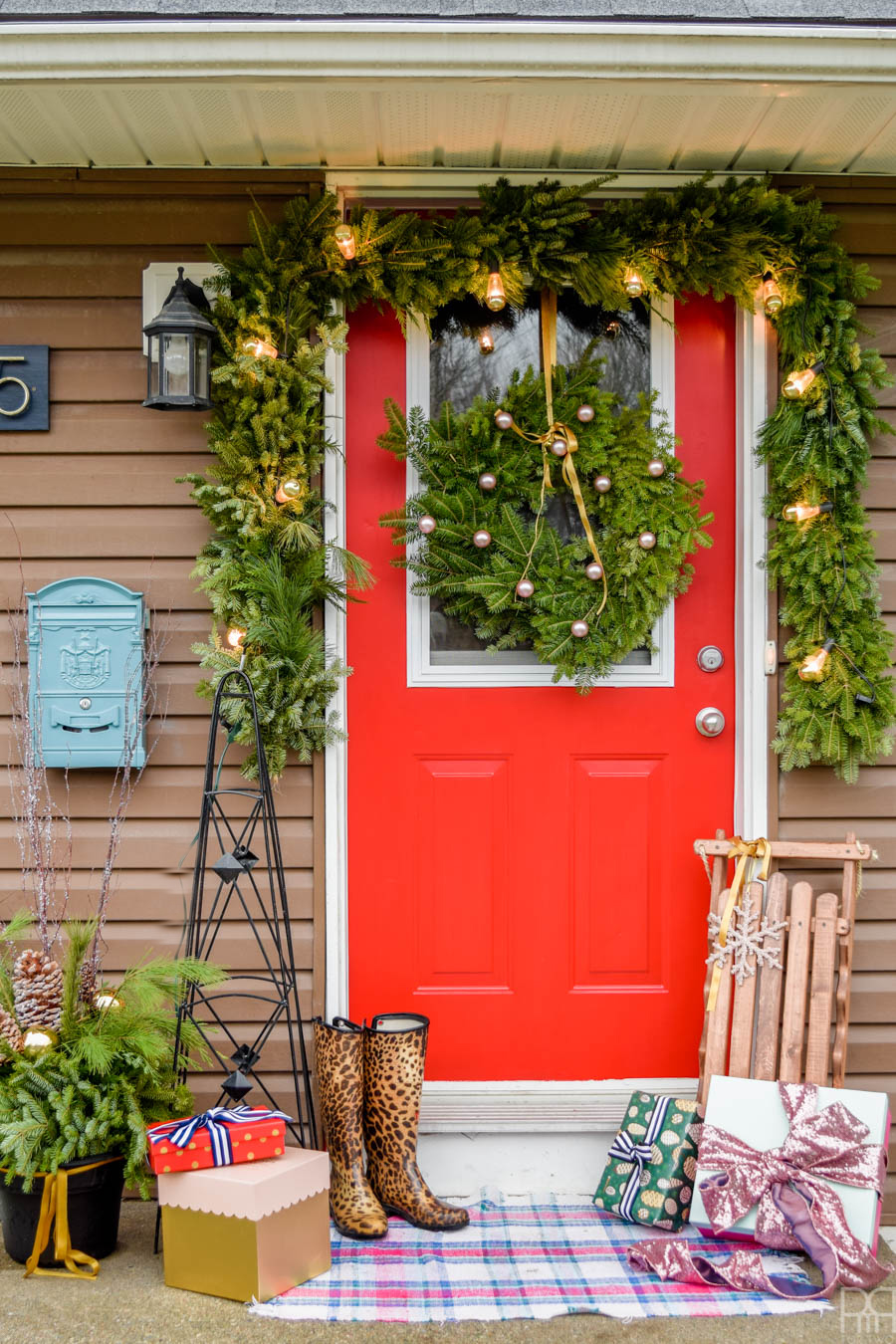 red front door with Christmas decorations