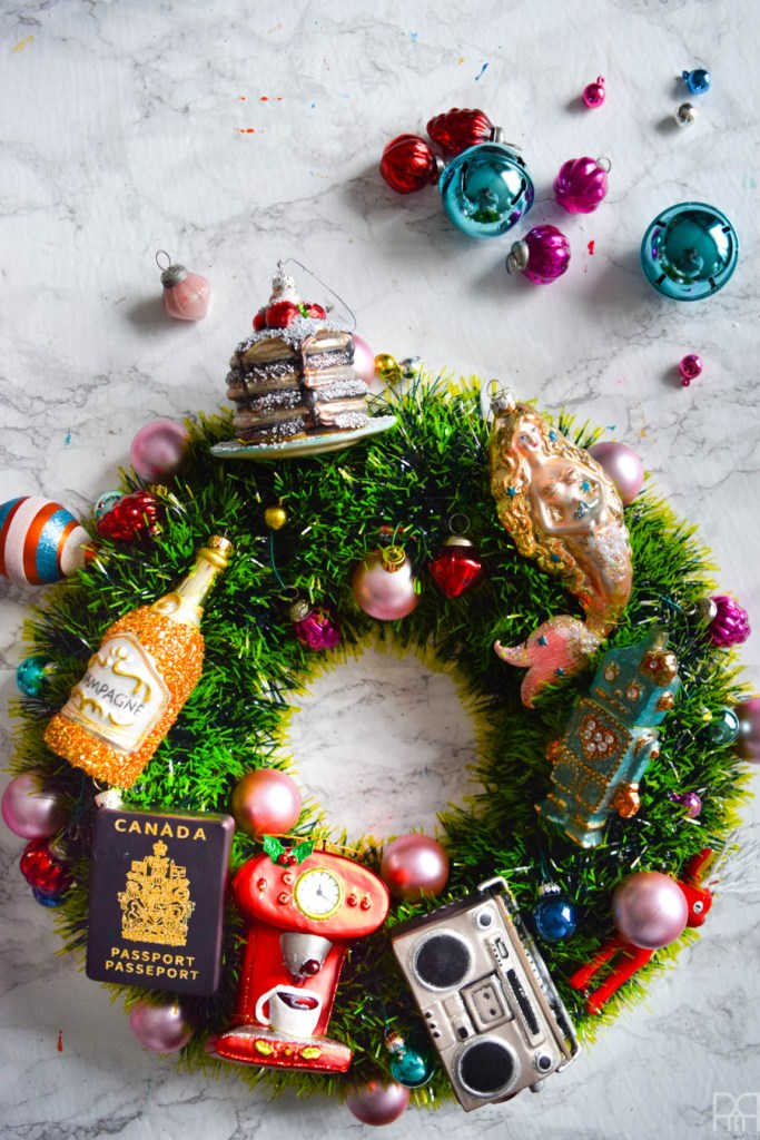 Instead of a generic store bought wreath, make a set with personal significance using your favourite ornaments and a little bit of ribbon. #maximalistdecor #christmasdecor #christmascraft #chrismastwreath #ornamentwreath