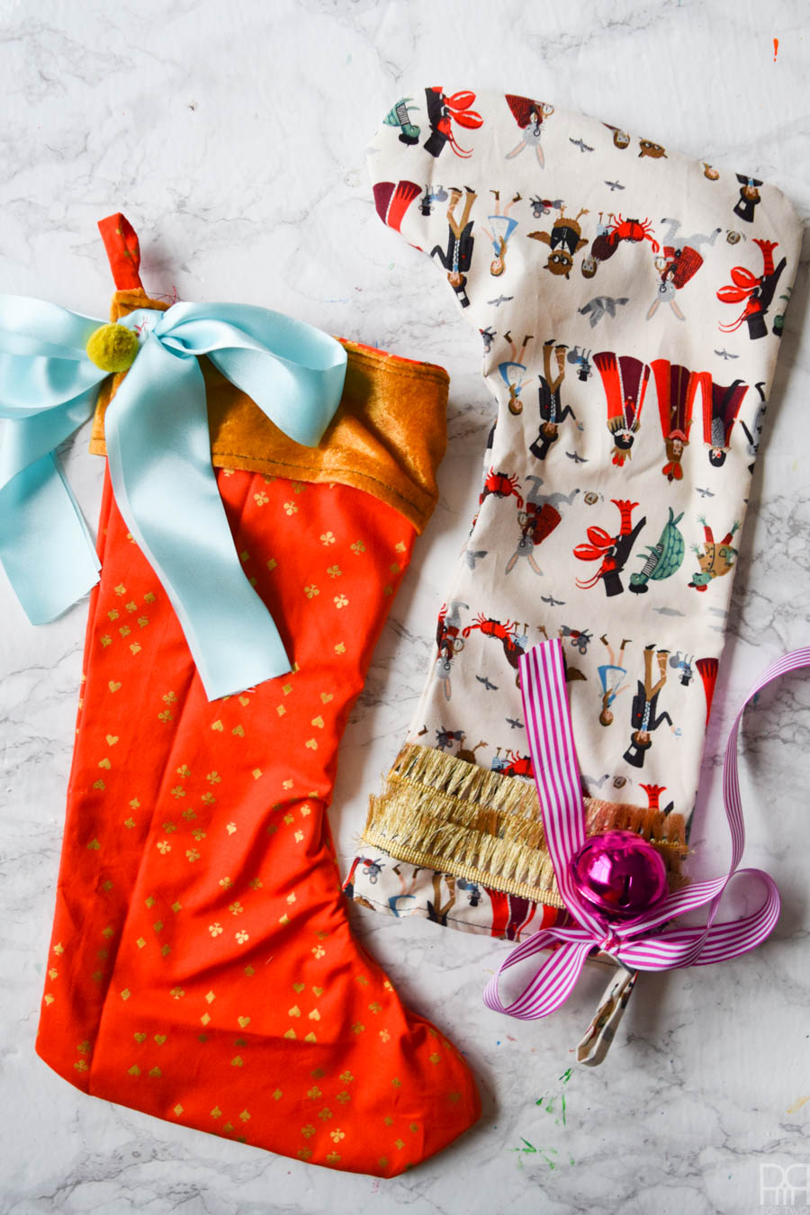 DIY Colourful Christmas Stockings are exactly what you need to kick it up a notch with your deco situation this year. Colourful fabric and vibrant trims create bold, show stopping accents.