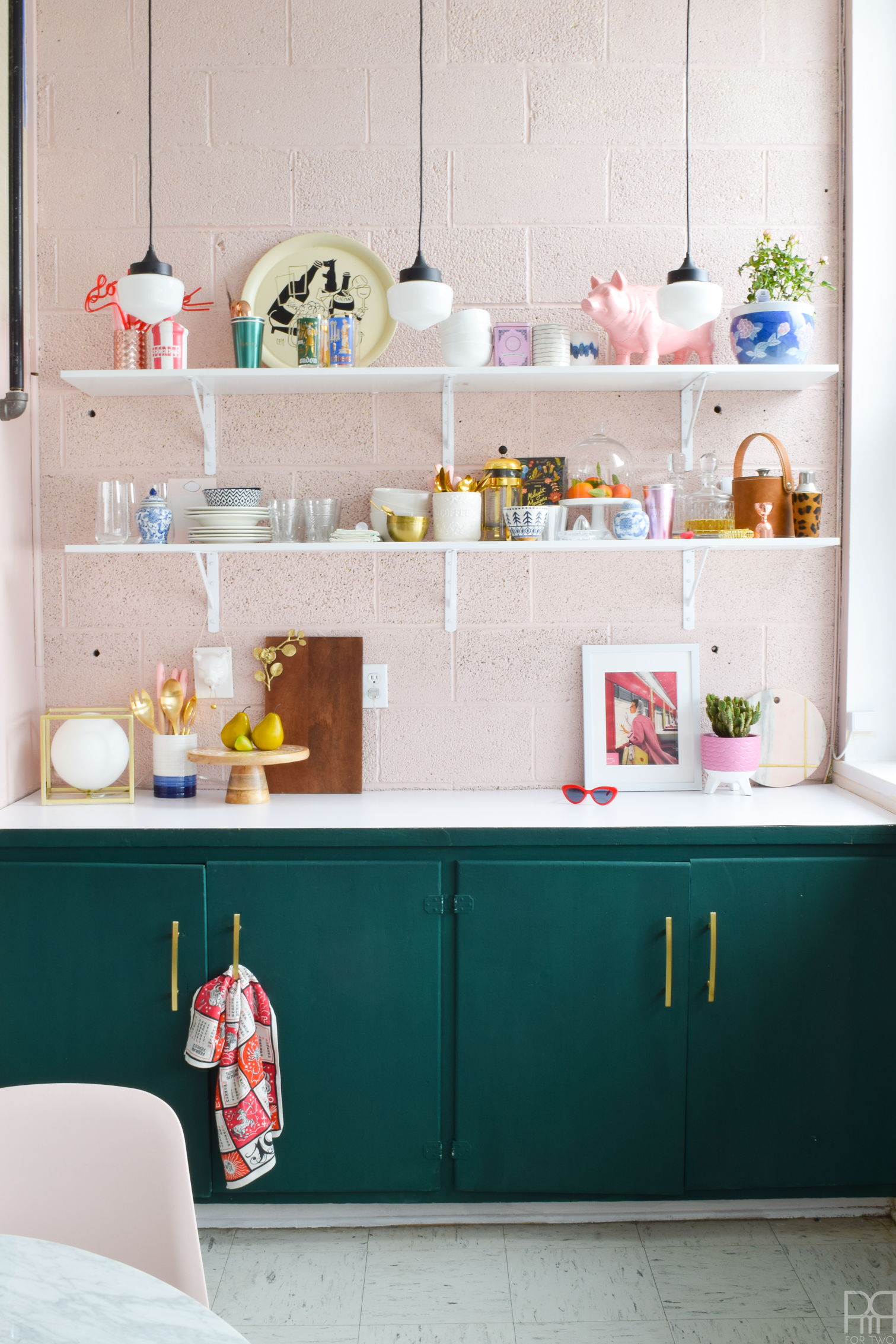 The eclectic & bold kitchen makeover to end all rental kitchen makeovers. Come see how we transformed this space using paint and well curated accessories. FAT Paint's Cascadia green & BEHR's Bella Mia truly get to shine in this makeover.