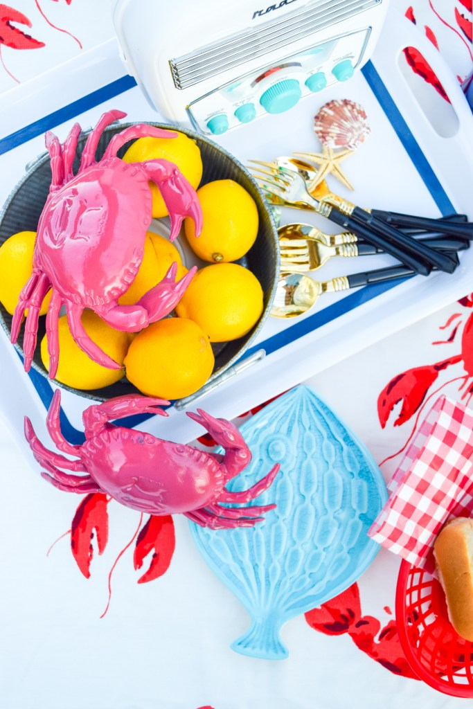 top down view of pink crabs, lemons and cutlery