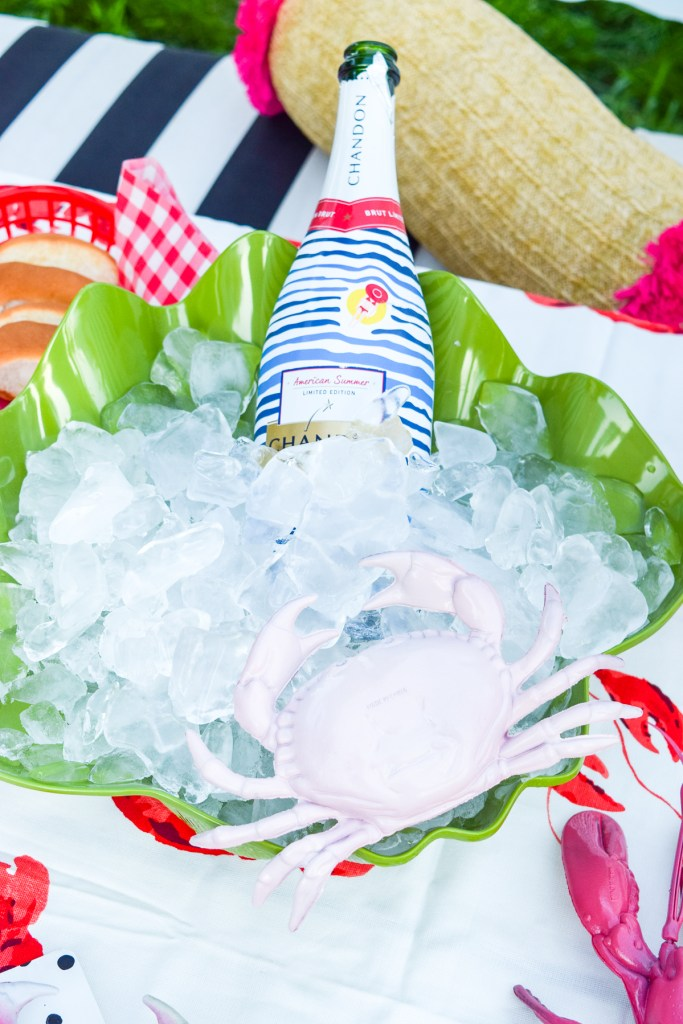 champagne bottle on ice with a pink crab
