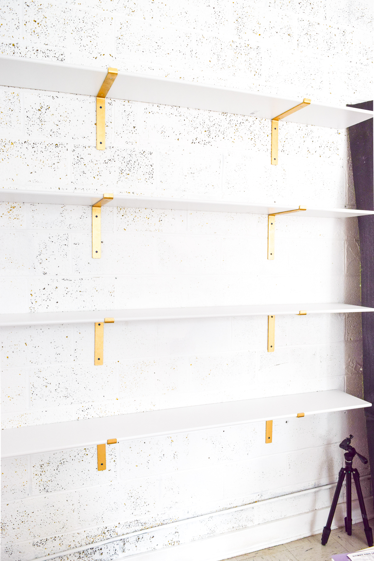 open shelving with old brackets