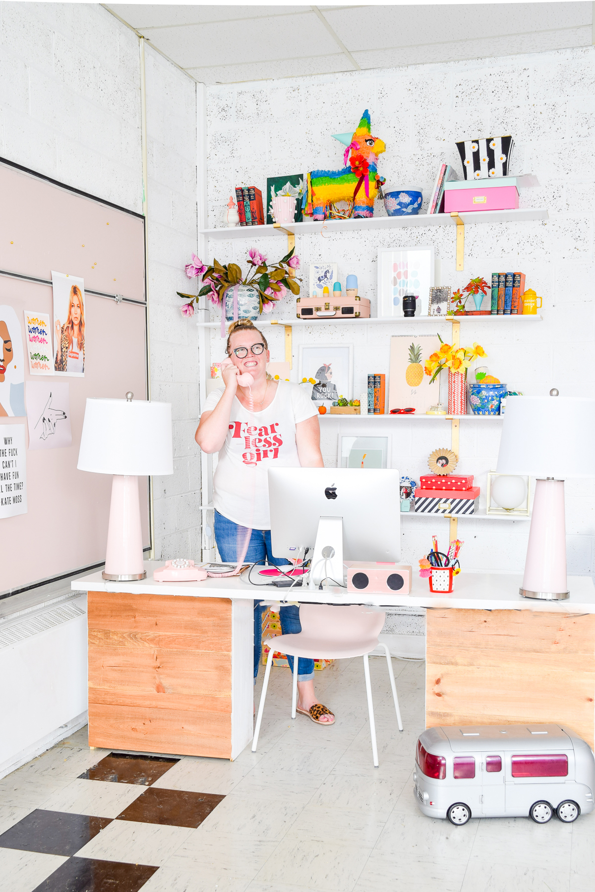 woman on the phone standing behind desk