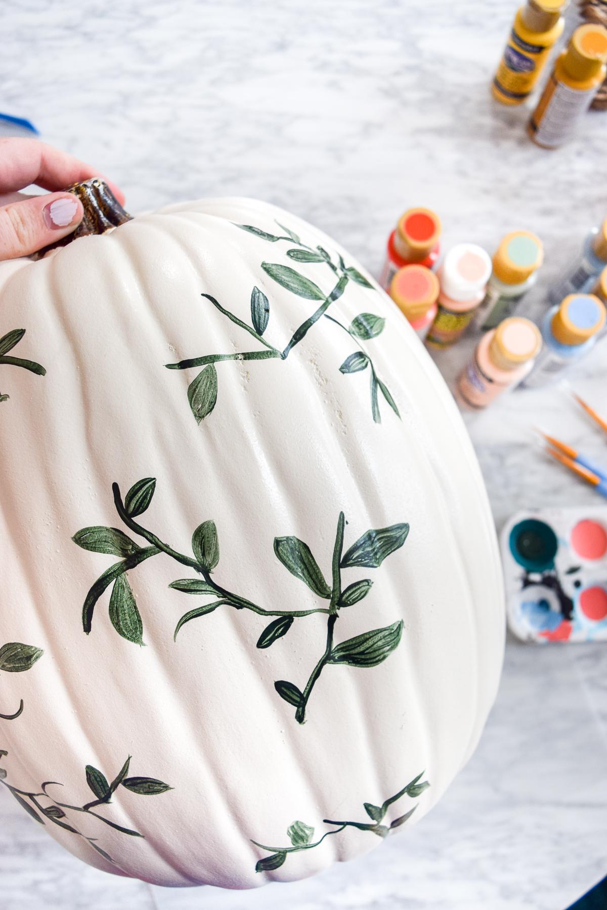 white pumpkin with green vines