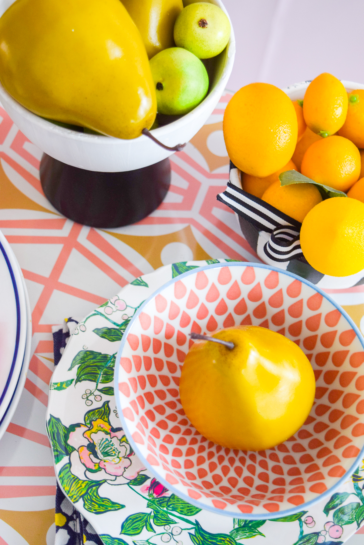 fruit in a bowl on a sideboard