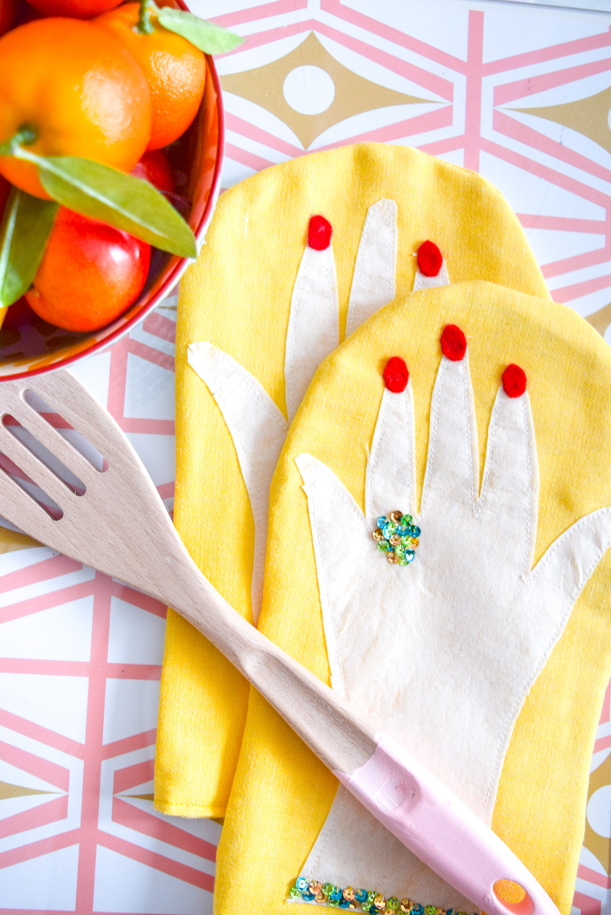spatula on hand shaped oven mitts