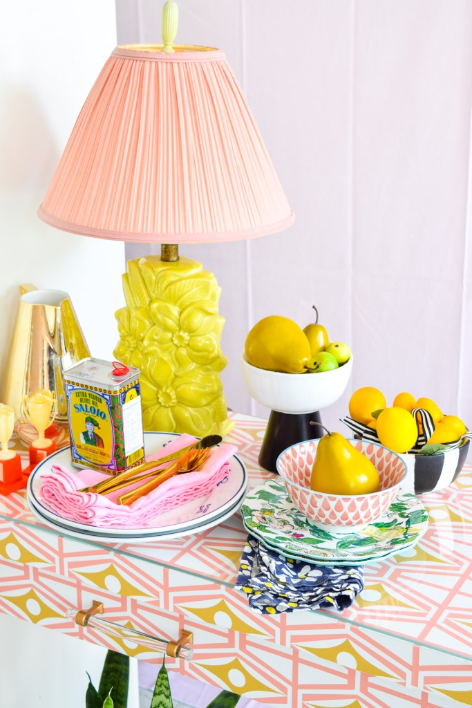 sideboard in funky retro pattern with plates and cutlery