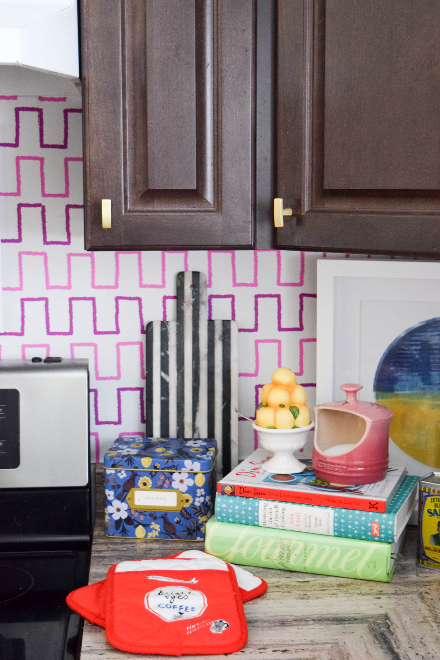 Life is too short to live with ugly rental kitchens. Fix it with a Removable Kitchen Wallpaper Backsplashusing a vibrant pattern from Spoonflower. All you need to get started are the measurements of your space, and the pattern you want! #wallpaper #removablewallpaper #backsplash #renterfriendly #kitchenupgrades