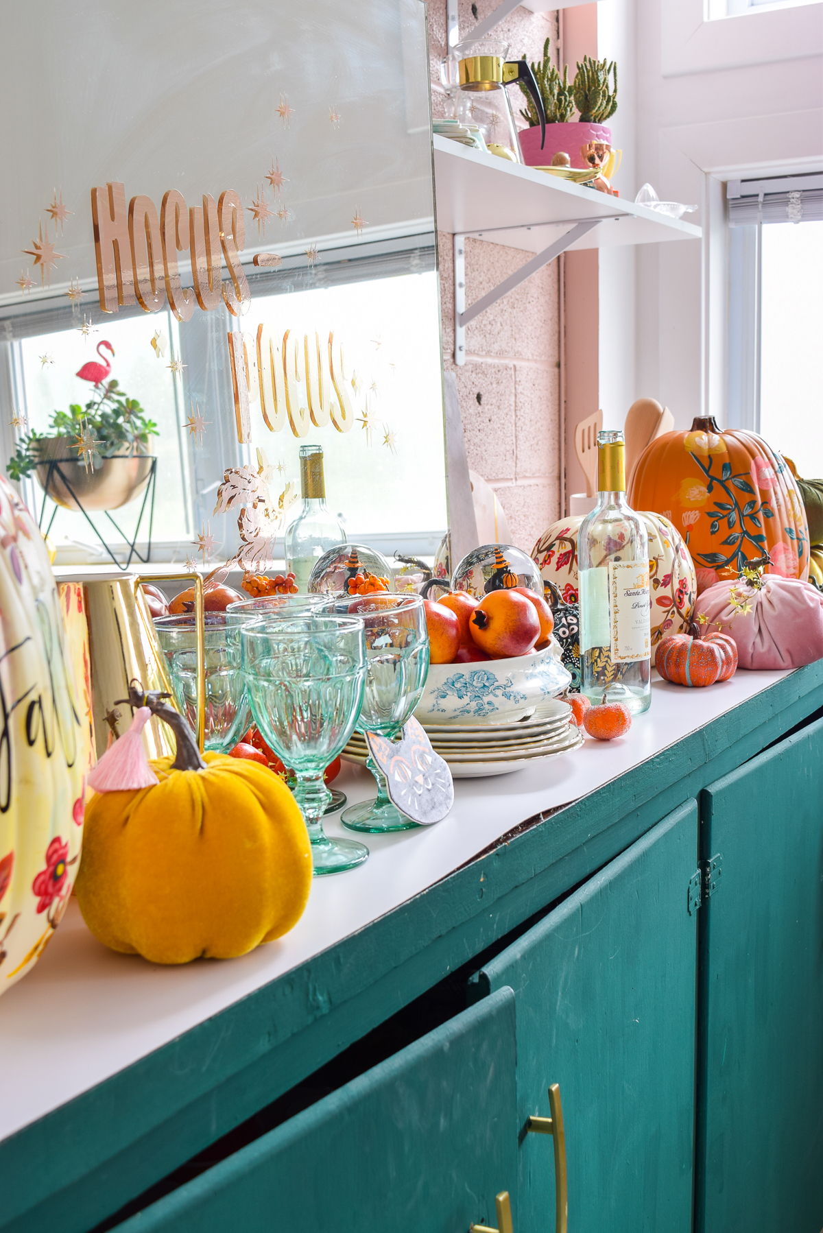 countertop decorated for fall with colourful pumpkins