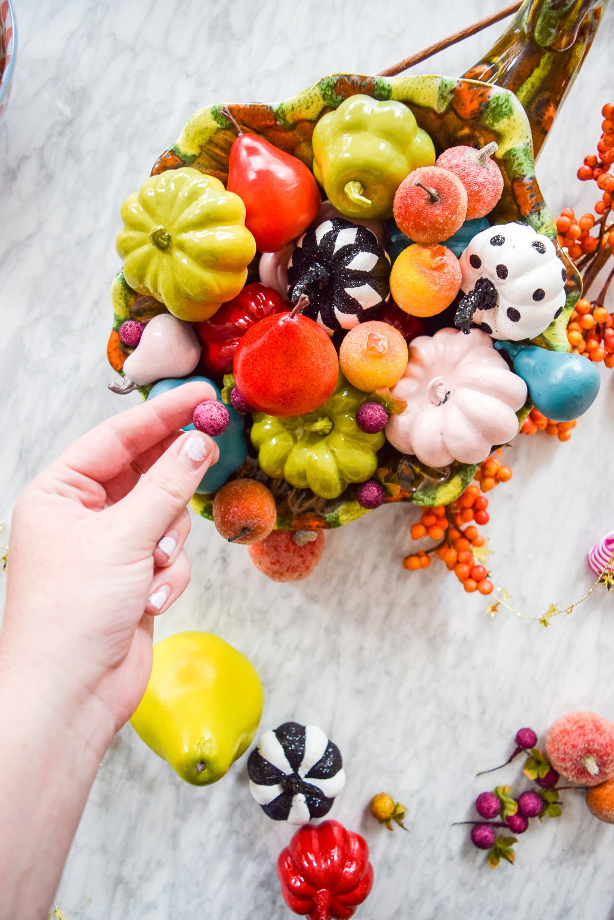 colourful pumpkins and candied fruit in a cornucopia