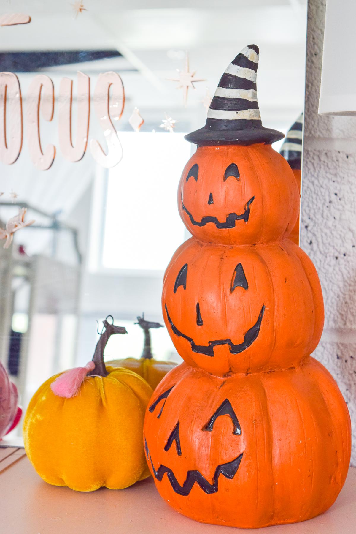 stacked pumpkin jack-o-lanterns