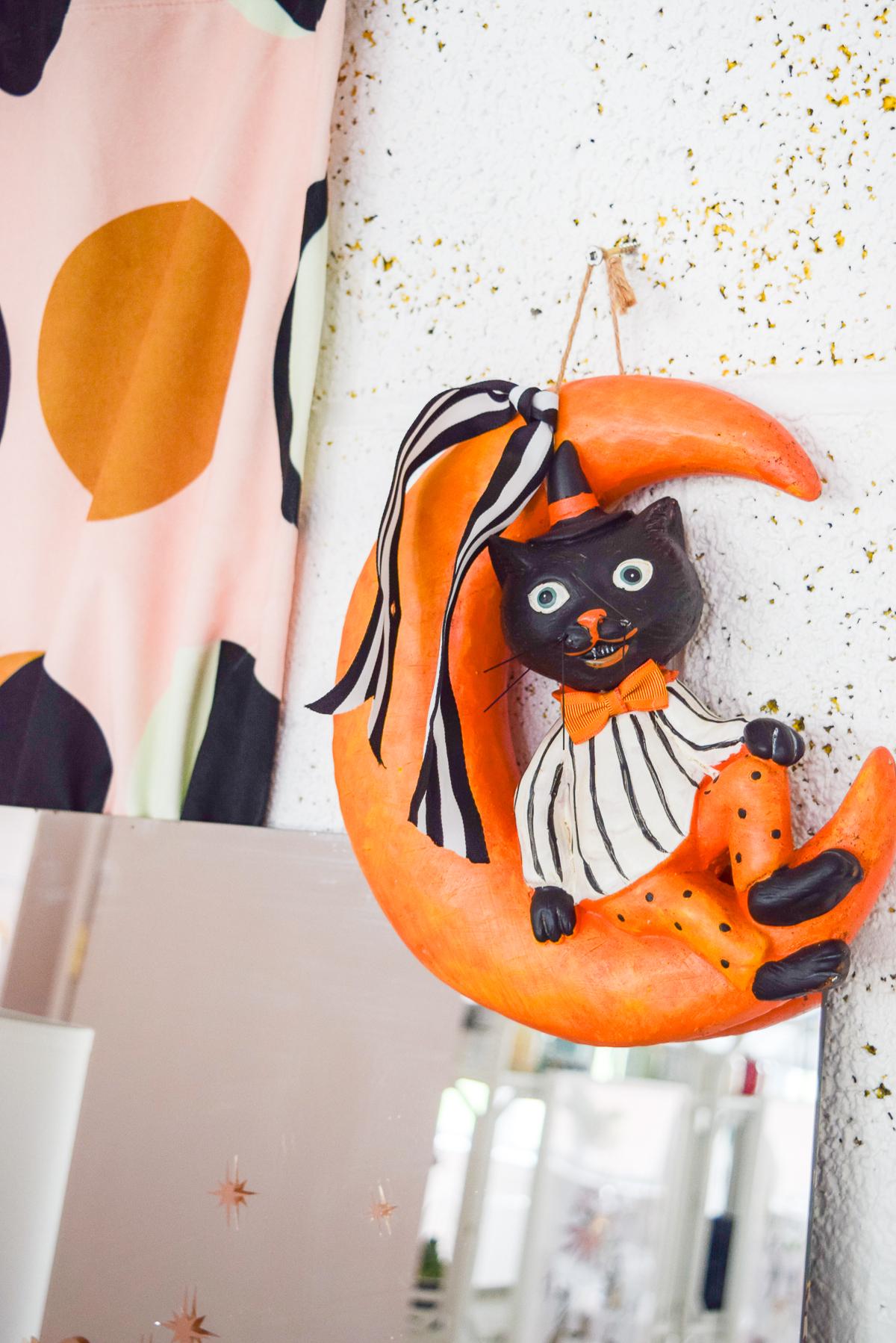 orange moon with black cat wreath