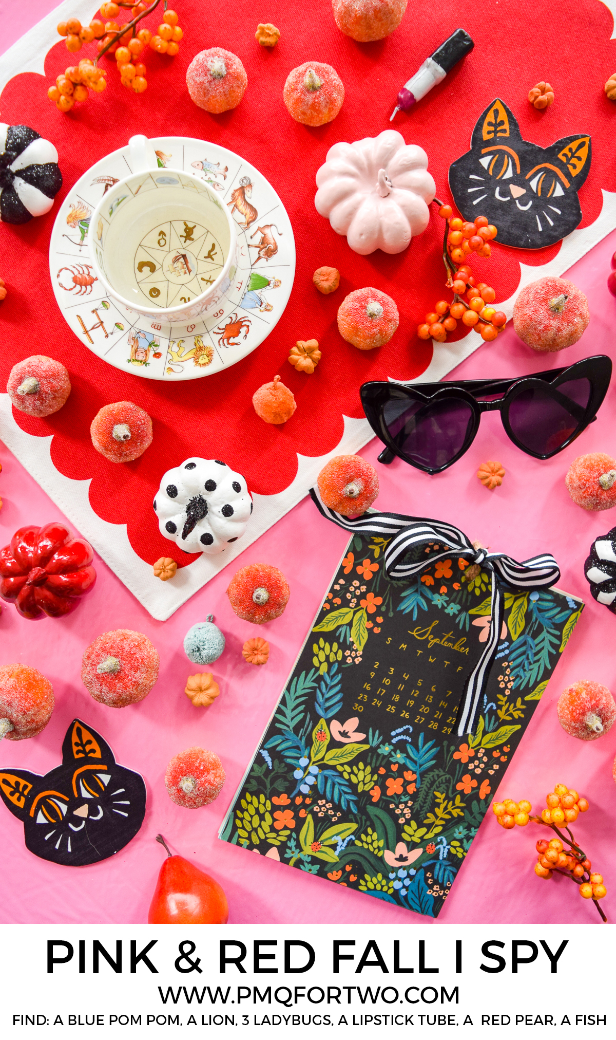 a pink and red flat lay tablescape with a calendar