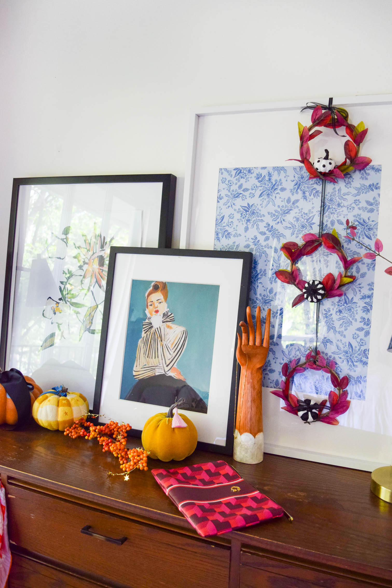 side shot of purple fall wreaths against art display
