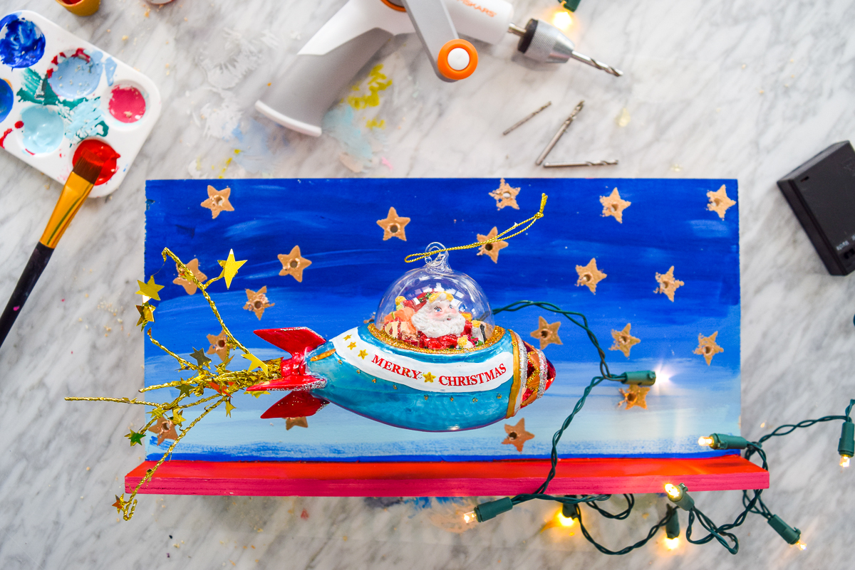 Bring some playful retro vibes into your Christmas decor with a DIY retro Santa marquee sign. With the Fiskars Precision hand drill you can create a custom sign in no time! #retro #marqueesign #christmasdecor