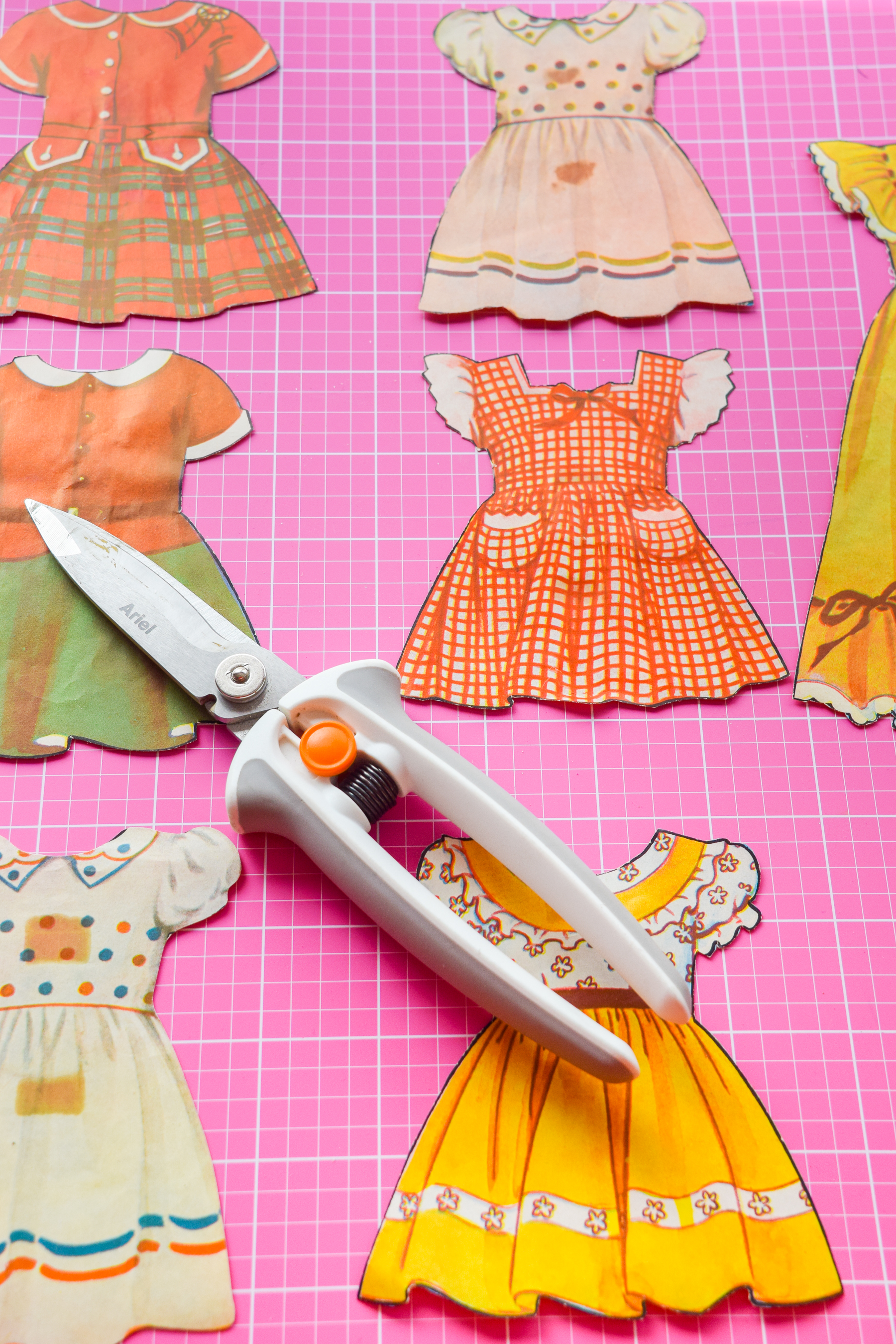 Got an old paper doll set? Add some magnetic sheeting them, and stick them to your fridge for a fun set of DIY retro doll fridge magnets.