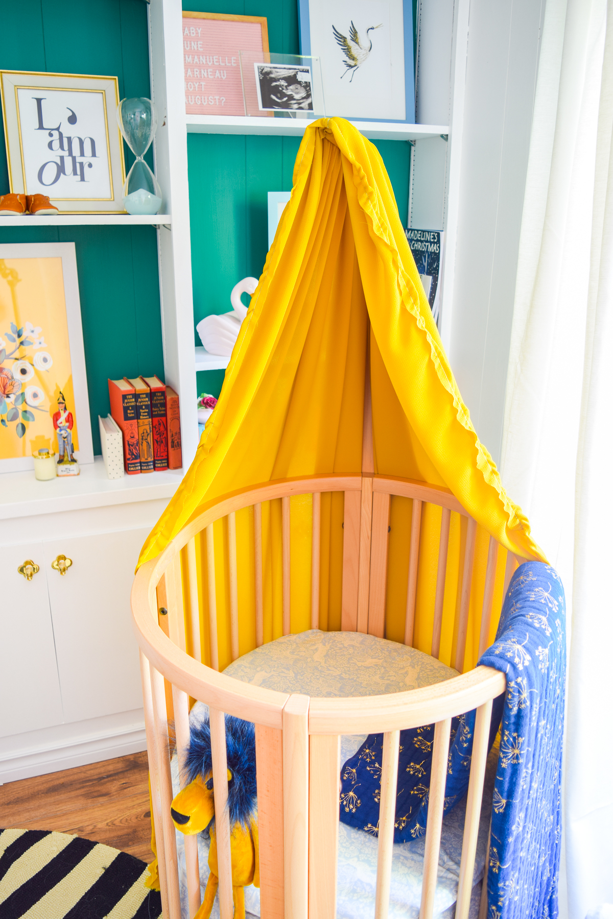 Our colorful baby girl nursery is full of pattern and texture. Between the swan rocker and the oval crib, what's not to love?