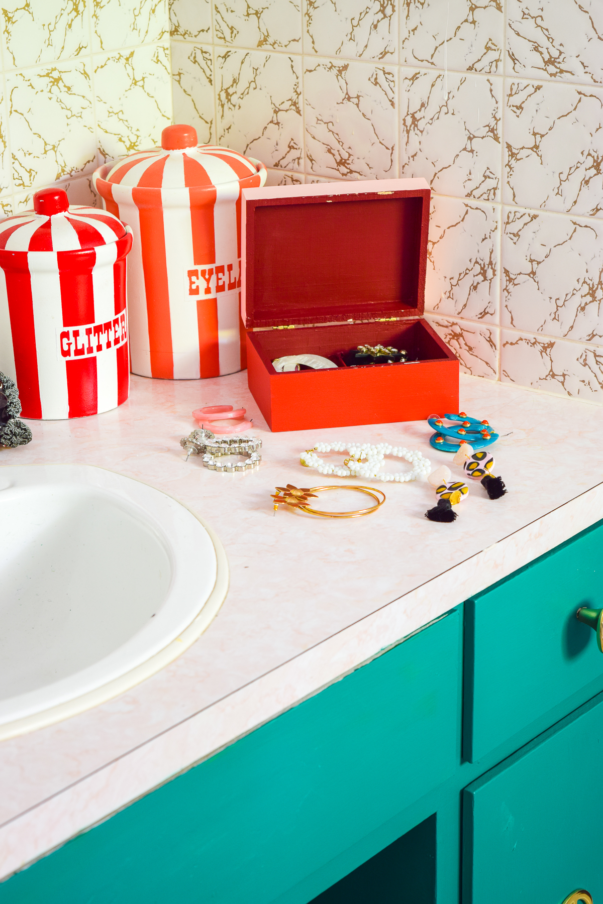 How to Remodel A Bathroom On A Budget - the eternal question! Let me tell you, it starts with paint, new hardware, and a shopping your house for decor.