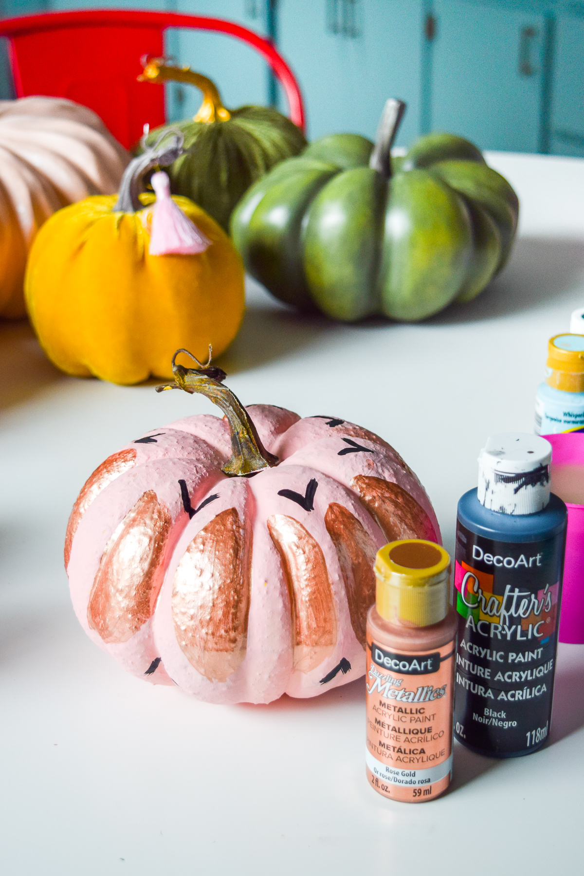 5 Colorful Pumpkin Painting Ideas that will bust you out of your creative rut, and have all your friends asking where you got such cool pumpkins this year. Using DecoArt's acrylic paints you can easily transfrom and re-use crafting pumpkins to create bold pops of colour.