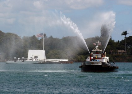 060808-N-4965F-019 Pearl Harbor, Hawaii (Aug. 8, 2006) Ð A tugboat assigned to Naval Station Pearl Harbor, energizes its firefighting hoses in front of the USS Arizona Memorial, celebrating the conclusion of Commander, Navy Region Hawaii, Commander, Naval Surface Group Middle Pacific, change of command ceremony. Rear Adm. Townsend G. Alexander relieved Rear Adm. Michael C. Vitale during the official ceremony. Alexander will serve as regional coordinator, managing the Navy's shore installations and be responsible for the training, maintenance and readiness of the 12 surface ships homeported at Pearl Harbor. U.S. Navy photo by Mass Communication Specialist 1st Class James E. Foehl (RELEASED)