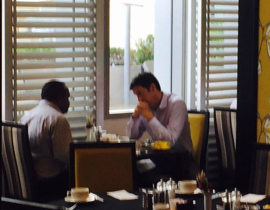 Sam Koim, former head of an Anti-corruption agency, Task Force Sweep, fraternising with British High Commissioner Simon Tong at Breakfast, Grand papua hotel this morning.
