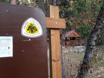 A large marker identifies the PNT at the Thirteen mile Trailhead
